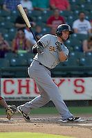 Salt Lake Bees outfielder Scott Cousins (5) follows through on his swing during the Pacific Coast League baseball game against the Round Rock Express on August 10, 2013 at the Dell Diamond in Round Rock, Texas. Round Rock defeated Salt Lake 9-6. (Andrew Woolley/Four Seam Images)