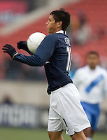 Brian Ching chests the ball down at Pizza Hut Park in Frisco, Texas, Sunday, Feb. 19, 2005.  USA won 4-0.