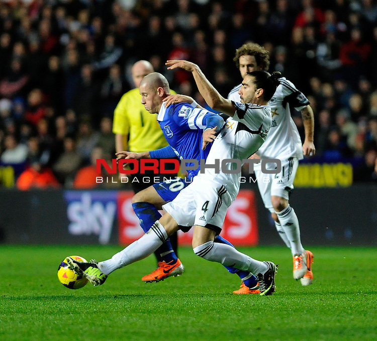 Everton's Ross Barkley is challenged by Swansea City's Chico -    22/12/2013 - SPORT - FOOTBALL - Liberty Stadium - Swansea - Swansea City v Everton - Barclays Premier League<br /> Foto nph / Meredith<br /> <br /> ***** OUT OF UK *****