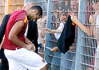 "Calcio, amichevole Roma vs Under 23 Indonesia. Rieti, stadio ""Manlio Scopigno"", 18 luglio 2014. <br /> AS Roma defender Mehdi Benatia, of Morocco, signs autographs to fans prior to the start of the friendly football match between AS Roma and Under 23 Indonesia at ""Manlio Scopigno"" stadium in Rieti, Italy, 18 July 2014.<br /> UPDATE IMAGES PRESS/Isabella Bonotto"