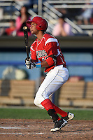 Batavia Muckdogs outfielder Kevin Grove (12) hits his first professional home run during a game against the Jamestown Jammers on July 25, 2014 at Dwyer Stadium in Batavia, New York.  Batavia defeated Jamestown 7-2.  (Mike Janes/Four Seam Images)