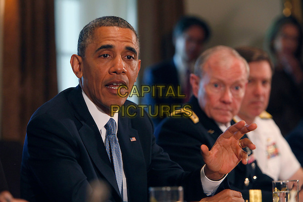 United States President Barack Obama meets with Chairman Martin Dempsey and service secretaries,service chiefs, and senior enlisted advisors to discuss sexual assault in the military, (left to right General Ray Odierno, Secretary of Defense Chuck Hagel, President Obama, Chairman Martin Dempsey, Vice Chief of Naval Operations Admiral Mark Ferguson.) .CAP/ADM/CNP/DB.©Dennis Brack/CNP/AdMedia/Capital Pictures