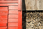 Sugar and Spice Store.Painted red wood barn siding and stored firewood.