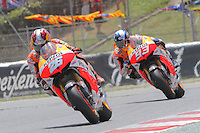 16.06.2013 Barcelona, Spain. Aperol Grand Prix of Catalonia. Picture show  Dani Pedrosa (Honda) and Marc Marquez (Honda) in action during Moto GP Racing  at Circuit de Catalunya