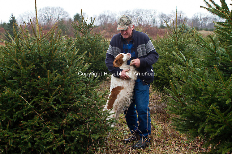 MIDDLEBURY, CT, 01 December, 2015 - 12015LW02 - Donald Groody embraces his dog,Toby, at Busy Acres Tree farm in Middlebury Tuesday. Groody volunteers to help out at the farm during the busy season between Thanksgiving and Christmas.<br /> Laraine Weschler Republican-American