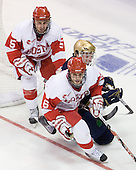 David Warsofsky (BU - 5), Kyle Palmieri (Notre Dame - 10), Joe Pereira (BU - 6) - The University of Notre Dame Fighting Irish defeated the Boston University Terriers 3-0 on Tuesday, October 20, 2009, at Agganis Arena in Boston, Massachusetts.