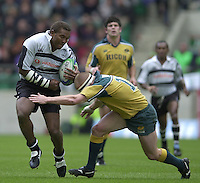 25/05/2002 (Saturday).Sport -Rugby Union - London Sevens.Australia vs Samoa.Salmoni Rokini tackles by Tim Walsh AUS[Mandatory Credit, Peter Spurier/ Intersport Images].