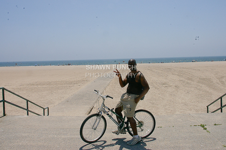 Me giving the peace sign on the beach, during my bike ride at Jacob Riis Park, June 25, 2011.