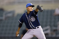 Asheville Tourists relief pitcher Cristian Quintin (30) in action against the Kannapolis Intimidators at Kannapolis Intimidators Stadium on May 26, 2016 in Kannapolis, North Carolina.  The Tourists defeated the Intimidators 9-6 in 11 innings.  (Brian Westerholt/Four Seam Images)