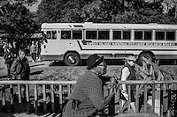 Cornelia Bailey sits outside of her small store in the Hog Hammock community on Sapelo Island as tourists arrive on a bus from the National Estuarine Research Reserve. Born and raised on Sapelo, Bailey is known as the island historian and one of the most vocal defenders of her island and its Geechee heritage.