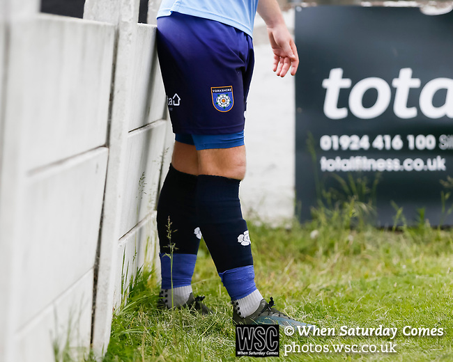 YIFA logo and white rose on the Yorkshire shorts and socks. Yorkshire v Parishes of Jersey, CONIFA Heritage Cup, Ingfield Stadium, Ossett. Yorkshire's first competitive game. The Yorkshire International Football Association was formed in 2017 and accepted by CONIFA in 2018. Their first competative fixture saw them host Parishes of Jersey in the Heritage Cup at Ingfield stadium in Ossett. Yorkshire won 1-0 with a 93 minute goal in front of 521 people. Photo by Paul Thompson