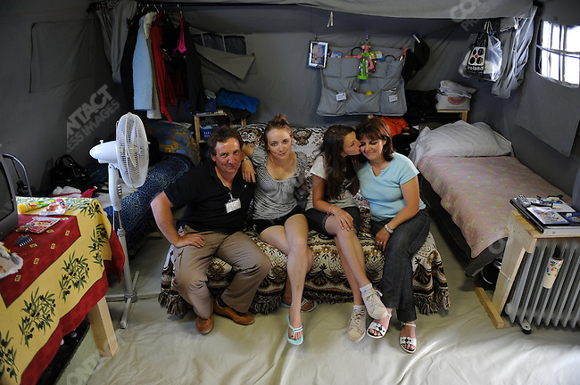 In the camp of piazza d'Armi in L'Aquila, where 1,300 people who lost their homes in the Abruzzo earthquake in April are now living in tents, Antonello Busicacchio with his wife Marina and daughters Ilaria and Alessandra, sat on their side of a tent for 8. May 22, 2009