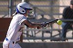 Western Nevada College's Madi Gonzalez bunts against Colorado Northwestern Community College at Edmonds Sports Complex in Carson City,Nev., on Friday, Feb. 21, 2014. Western swept the doubleheader 10-2 and 7-2.<br /> Photo by Cathleen Allison/Nevada Photo Source