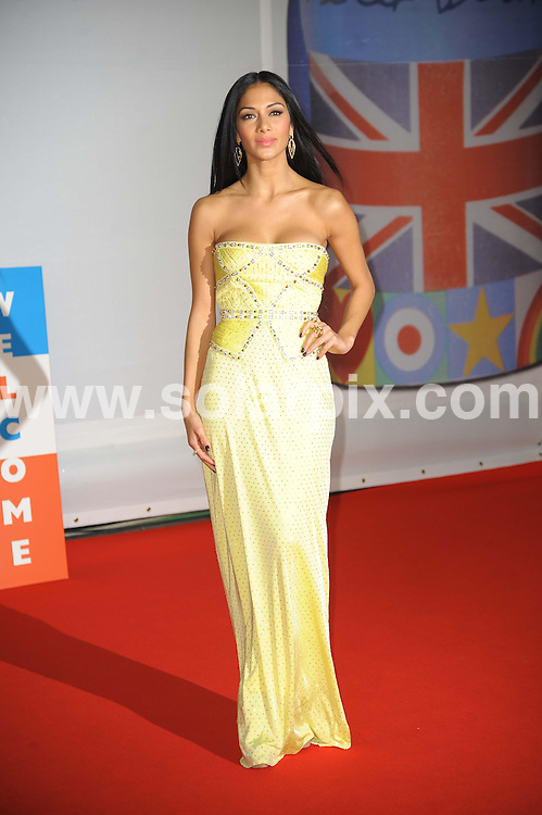 **ALL ROUND PICTURES FROM SOLARPIX.COM**                                             **WORLDWIDE SYNDICATION RIGHTS**                                                                                  Stars arrive at London's O2 Arena for the 2012 Brit Awards..This pic:    Nicole Scherzinger                                                                                           JOB REF:    14495   MSR     DATE:   22.02.12                                                         **MUST CREDIT SOLARPIX.COM OR DOUBLE FEE WILL BE CHARGED**                                                                      **MUST AGREE FEE BEFORE ONLINE USAGE**                               **CALL US ON: +34 952 811 768 or LOW RATE FROM UK 0844 617 7637**