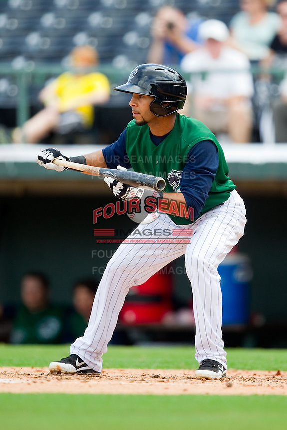 Leury Garcia (7) of the Charlotte Knights squares to bunt against the Durham Bulls at Knights Stadium on August 18, 2013 in Fort Mill, South Carolina.  The Bulls defeated the Knights 8-5 in Game One of a double-header.  (Brian Westerholt/Four Seam Images)