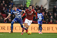 Marlon Pack of Bristol City is challenged by Chris Gunter of Reading during the Sky Bet Championship match between Bristol City and Reading at Ashton Gate, Bristol, England on 26 December 2017. Photo by Paul Paxford.