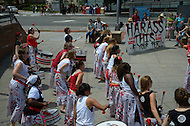 """June 26, 2011 (Washington, DC)  A few dozen protesters gathered in the Adams Morgan section of Washington to protest street harassment and gender violence.  """"Our Streets Too"""" was their slogan and rally cry.  Entertainment at the rally included Batala-Banda de Percussao, an all-female drum group.  (Photo: Don Baxter/Media Images International)"""