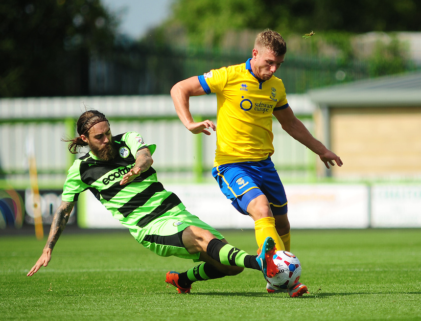 Forest Green Rovers' Rob Sinclair vies for possession with Lincoln City's Jack Muldoon<br /> <br /> Photographer Andrew Vaughan/CameraSport<br /> <br /> Football - Vanarama National League - Forest Green Rovers v Lincoln - Saturday 22nd August 2015 - The New Lawn - Nailsworth<br /> <br /> &copy; CameraSport - 43 Linden Ave. Countesthorpe. Leicester. England. LE8 5PG - Tel: +44 (0) 116 277 4147 - admin@camerasport.com - www.camerasport.com
