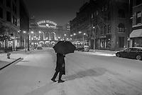A pedestrian braves the cold and blowing snow in Lower Downtown, Denver- or LoDo as we locals call it.