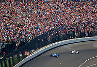 May 28, 2017; Indianapolis, IN, USA; IndyCar Series driver Takuma Sato (26) leads Helio Castroneves off of turn four on the final lap of the 101st Running of the Indianapolis 500 at Indianapolis Motor Speedway. Mandatory Credit: Mark J. Rebilas-USA TODAY Sports