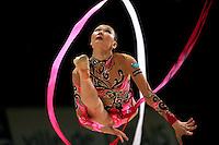Aliya Yussupova of Kazakhstan inbound view of split leap with ribbon at 2007 Thiais Grand Prix near Paris, France on March 24, 2007.