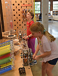 Hollyn Thonen (left) watches her air pressure-powered rocket blast up the tube as Adilyn Runge, cranks the wheel at her station to pressurize the system. Both are 10 years old. The Magic House had two fourth-grade classes from the New City School visit their new permanent satellite location at 5127 Delmar Boulevard in St. Louis, MO on Wednesday May 23, 2019.<br /> Photo by Tim Vizer