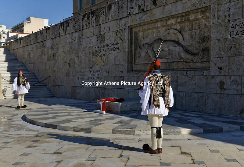 Pictured: Presidential Guards known as Tsoliades stand by the wreath left by Turkey president Recep Tayyip Erdogan at the Unknown Soldier Monument outside the Greek Parliament in Syntagma Square.<br /> Re: Turkey's president Recep Tayyip Erdogan has begun a landmark visit to Greece. Thursday 07 December 2017