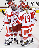 Tara Watchorn (BU - 27), Catherine Ward (BU - 17), Jenn Wakefield (BU - 9), Holly Lorms (BU - 8) and Jenelle Kohanchuk (BU - 19) celebrate Lorms' goal which made it 3-0 BU just 39 seconds into the third period. - The Northeastern University Huskies tied Boston University Terriers 3-3 in the 2011 Beanpot consolation game on Tuesday, February 15, 2011, at Conte Forum in Chestnut Hill, Massachusetts.