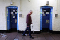 An elderly prisoner walks past cells in the vulnerable prisoners unit on the H wing in the Onslow building at Wandsworth prison..HMP Wandsworth in South West London was built in 1851 and is one of the largest prisons in Western Europe. It has a capacity of 1456 prisoners.