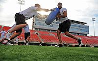 Jun. 13, 2009; Las Vegas, NV, USA; Michael Allan (left) does training drills with Marcus Freeman during the United Football League workout at Sam Boyd Stadium. Mandatory Credit: Mark J. Rebilas-