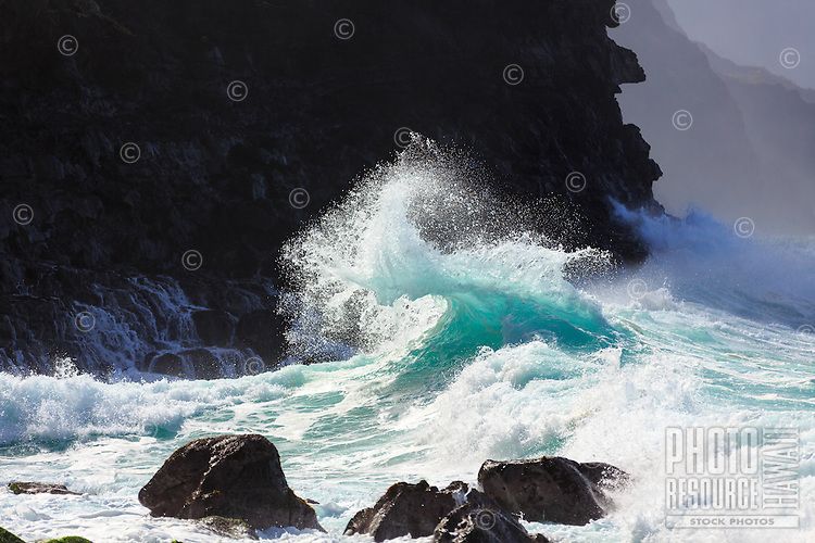 A wave jumps in a dynamic display of energy towards the shore at Ke'e Beach, Na Pali Coast, Kaua'i.