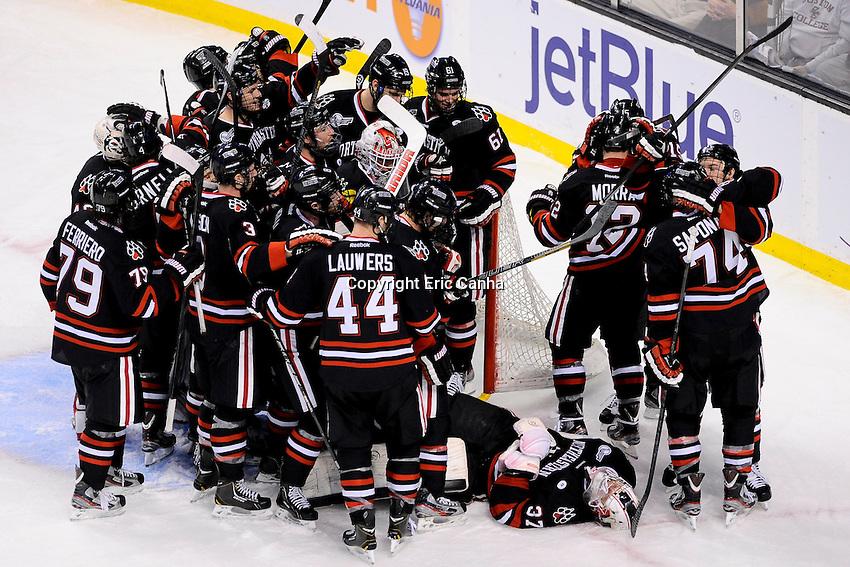 The Northeastern University Huskies celebrate their victory in the first semi-final Beanpot Tournament hockey game between Boston University and Northeastern University held at TD Garden in Boston Massachusetts.  Eric Canha/CSM