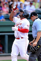 Left fielder Carlos Mesa (28) of the Greenville Drive points to the sky after hitting a home run in a game against the Hagerstorn Suns on May 12, 2015, at Fluor Field at the West End in Greenville, South Carolina. Greenville won, 4-0. (Tom Priddy/Four Seam Images)