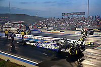 Jul. 19, 2013; Morrison, CO, USA: NHRA crew members for top fuel dragster driver Antron Brown during qualifying for the Mile High Nationals at Bandimere Speedway. Mandatory Credit: Mark J. Rebilas-