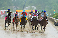 BALTIMORE, MD - MAY 21: Nyquist #3, ridden by Mario Gutierrez (L), and Uncle Lino #2, ridden by Fernando Hernandez Perez, (R) lead the field past the grandstands for the first time during Preakness Stakesat Pimlico Race Course on May 21, 2016 in Baltimore, Maryland. (Photo by Amy K. Dragoo/Eclipse Sportswire/Getty Images)