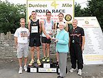 Marie Carrie presents the tropjhy to the Winner of the Dunleer 4 mile run Mark Hoey from Team Carrie, second place Thomas Cotter from Dunleer AC, Third place Datrragh Greene from Dunleer AC, also in photo David Carrie and Pat Cheshire. Photo: Colin Bell/pressphotos.ie