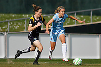Kacey White (20) of Sky Blue FC is chased by Liz Bogus (17) of the Los Angeles Sol. The Los Angeles Sol defeated Sky Blue FC 2-0 during a Women's Professional Soccer match at TD Bank Ballpark in Bridgewater, NJ, on April 5, 2009. Photo by Howard C. Smith/isiphotos.com