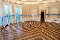 Plastic covers the walls of the Oval Office in the White House West Wing in Washington, DC as it is undergoing renovations while United States President Donald J. Trump is vacationing in Bedminster, New Jersey on Friday, August 11, 2017.  This photo is looking towards the windows where the President's desk usually sits.<br /> Credit: Ron Sachs / CNP /MediaPunch