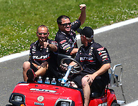 May 31, 2014; Englishtown, NJ, USA; Crew members cheer as they go down the return road after NHRA pro stock driver Erica Enders-Stevens runs a 6.47  at 215mph during qualifying for the Summernationals at Raceway Park. Mandatory Credit: Mark J. Rebilas-