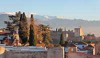 The Alcazaba, the defensive fortress of the Alhambra Palace, Granada, Andalusia, Southern Spain, built under Mohammed I in the 13th century, seen from the San Cristobal viewpoint. In the foreground is the Muralla de la Alcazaba, an 8th century wall protecting El Albayzin, the medieval Moorish old town of Granada. The Alhambra was begun in the 11th century as a castle, and in the 13th and 14th centuries served as the royal palace of the Nasrid sultans. The huge complex contains the Alcazaba, Nasrid palaces, gardens and Generalife. In the distance are the snow-capped peaks of the Sierra Nevada. Picture by Manuel Cohen