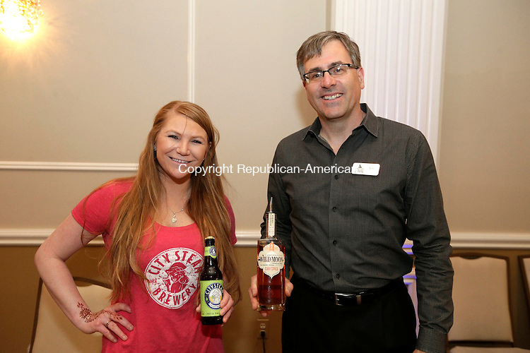 Waterbury, CT- 27 April 2016-042716CM14- SOCIAL MOMENTS From left to right, Megan McCue of City Steam Brewery of Hartford and Tom Dubay of Hartford Flavor Company are photographed during The Waterbury Exchange Club Charitable Foundation 22nd Annual Wine & Beer Tasting at the La Bella Vista in Waterbury on Wednesday.  Christopher Massa Republican-American