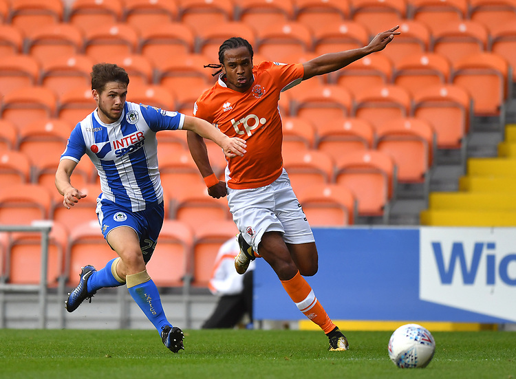 Blackpool's Nathan Delfouneso battles with Wigan Athletic's Luke Burke<br /> <br /> Photographer Dave Howarth/CameraSport<br /> <br /> The EFL Checkatrade Trophy - Blackpool v Wigan Athletic - Tuesday 29th August 2017 - Bloomfield Road - Blackpool<br />  <br /> World Copyright &copy; 2018 CameraSport. All rights reserved. 43 Linden Ave. Countesthorpe. Leicester. England. LE8 5PG - Tel: +44 (0) 116 277 4147 - admin@camerasport.com - www.camerasport.com