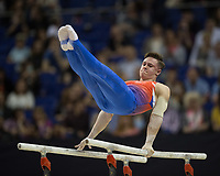 Brinn Bevan (GBR) in action during the men's Parallel Bars competition.  FIG World Cup Series of Gymnastics. The O2 Arena, London,  Britain 8th April 2017.