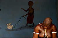 """a  """"trokosi"""" religious slave  performs a pagan traditional ritual under the supervision in one of the shrines of Atito in the Volta region, Ghana on Saturday March 10 2007.."""