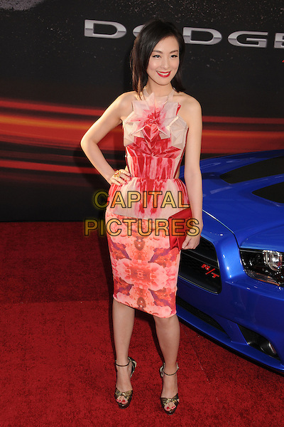 "Sarah Li.""Fast & Furious 6"" Los Angeles Premiere held at the Universal Gibson Amphitheatre, Universal City, California, USA..May 21st, 2013.full length white red pattern dress hand on hip clutch bag.CAP/ADM/BP.©Byron Purvis/AdMedia/Capital Pictures"