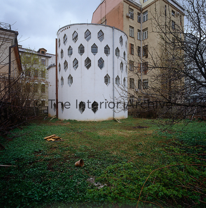 The unusual cylindrical shape of the Melnikov residence seen from the neglected garden
