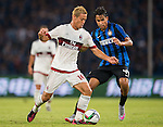 Keisuke Honda of AC Milan (L) competes for the ball with Pedro Miguel Gomes Delgado of FC Internazionale Milano (R) during the AC Milan vs FC Internacionale as part of the International Champions Cup 2015 at the looks onnggang Stadium on July 25, 2015 in Shenzhen, China.  Photo by Aitor Alcalde / Power Sport Images