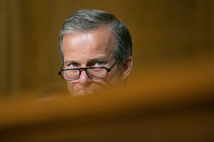"UNITED STATES - August 4: Sen. John Thune, R-S.D., listens during the Senate Finance Committee hearing on ""A Way Back Home: Preserving Families and Reducing the Need for Foster Care"" in the Dirksen Senate Office Building in Washington, Tuesday, August 4, 2015. (Photo By Al Drago/CQ Roll Call)"