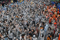 Naga Sadhus (naked saints) on their way to holy dip during the first Sahi Snan (Royal dip) at Kumbh mela on 12th February 2010. Haridwar, Uttara Khand, India, Arindam Mukherjee