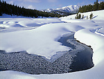 Sawtooth National Recreation Area, ID<br /> Open ice &amp; snow covered banks of the Big Wood River w/ distant Sawtooth Mts